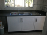 top granites fitted kitchen with square line doors